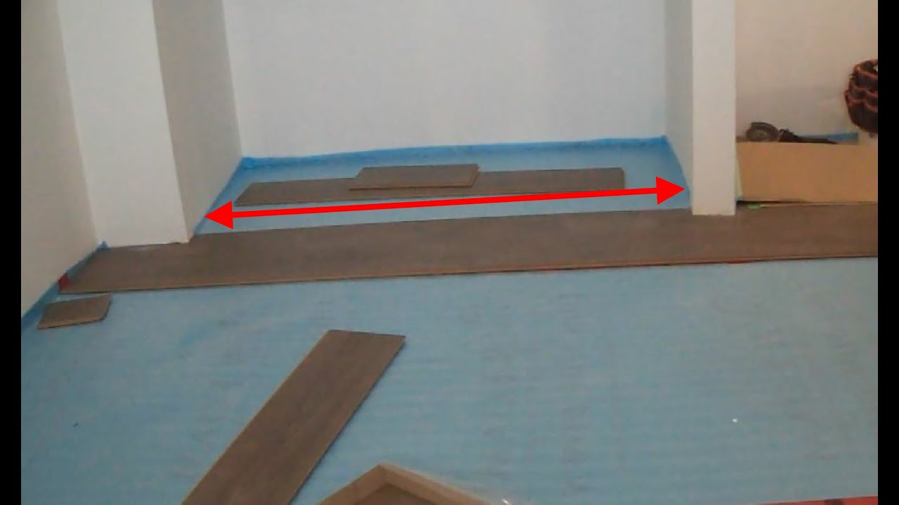 how to install laminate wood flooring under a closet door youtube