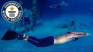 Longest distance swam underwater holding breath - Guinness World Records
