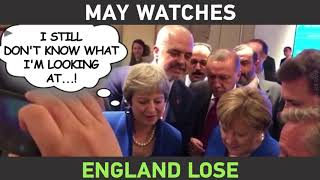 May watches England vs Croatia on mobile phone during NATO summit