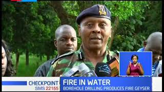 FIRE IN WATER: Workers scamper for safety as borehole oozes fire geyser, police seal off the area