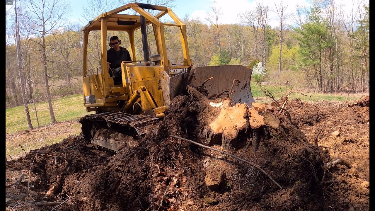 Digging out stumps with a dozer