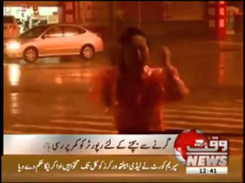 News Reporter Secured with a Rope in Sea Storm News Package 17 August 2012