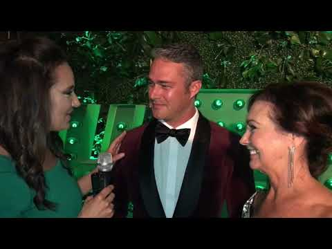 biz Shelly talks to Taylor Kinney and his mom at the Green Tie Ball