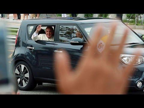 Pope Francis squeezes into Kia in Seoul for South Korea tour