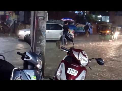 Man saving people from pothole(open manhole cover) in rainy Bangalore traffic