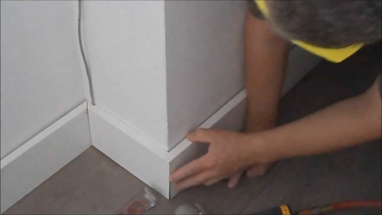 How to cut base molding in place - How To Install Baseboards To Laminate Or Hardwood Flooring Diy Mryoucandoityourself Youtube
