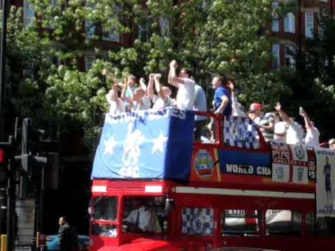 Chelsea fans on open top Bus on Marylebone Road