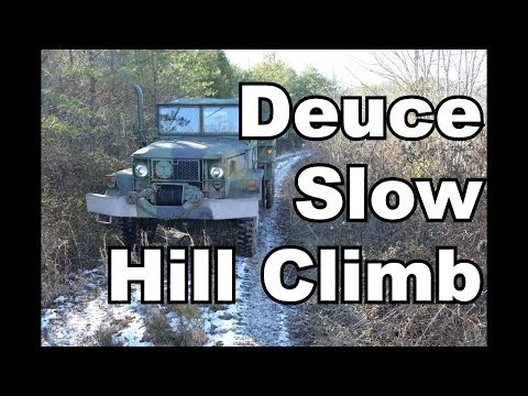 Deuce Idling up a hill with some snow and mud.