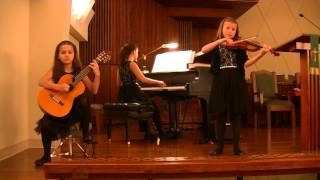 Canon in D on piano, violin, and classical guitar.