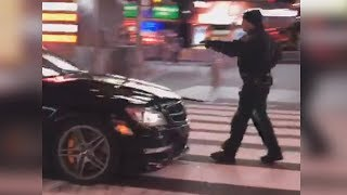 NYPD officer hit by car