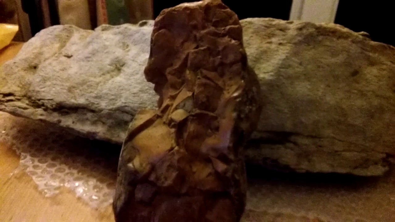 Stone mermaid carving of a pre flood woman mud fossils