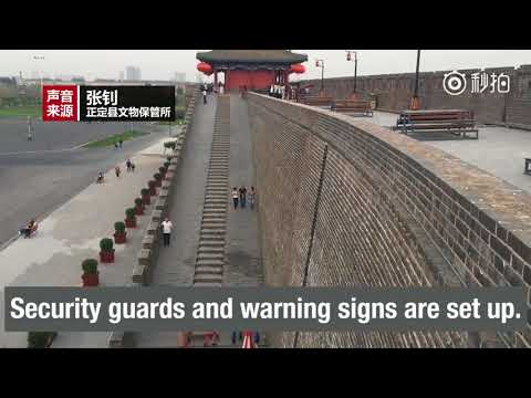 Be civilized: Authorities warn tourists not to climb ancient city walls in N. China