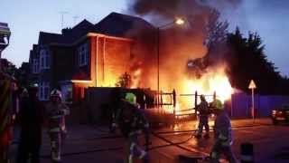 burning house fire kent fire and rescue put out flames