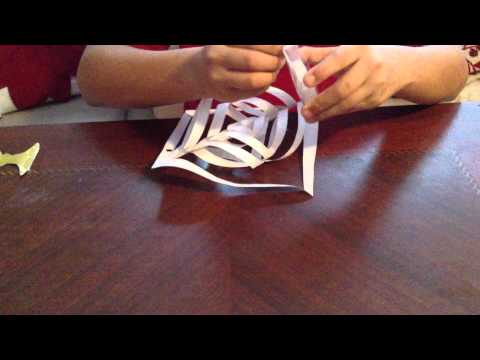 Make a super cool, giant, three-dimensional paper snowflake