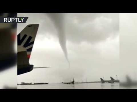 Damaged planes & toppled buses: Tornado wreaks havoc on Turkish airport