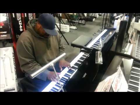 Lil JT and JT at Sam Ash music store on keys