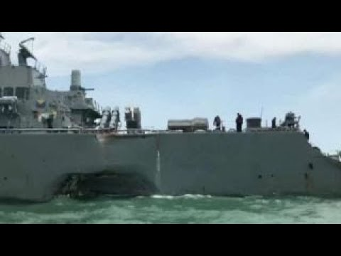 Search under way for 10 US sailors missing...