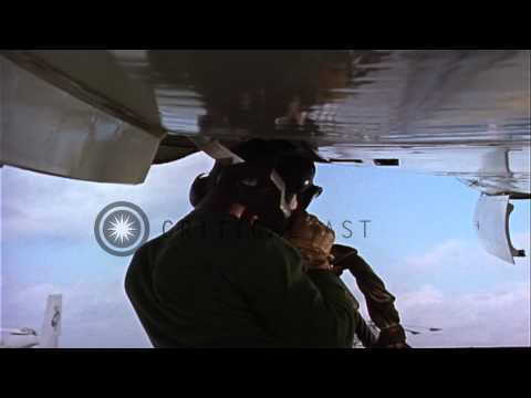 Catapult crew hooks bridle to aircraft aboard USS Essex (CVA-9) in Mediterranean ...HD Stock Footage