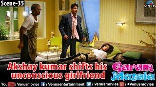 Akshay Kumar shifts his unconscious Girlfriend (Garam Masala)