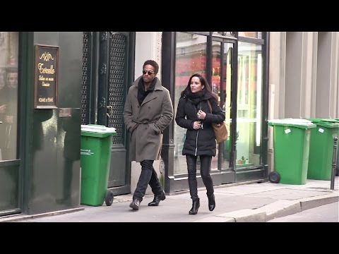 EXCLUSIVE - Gary Dourdan and a mystery woman in Paris