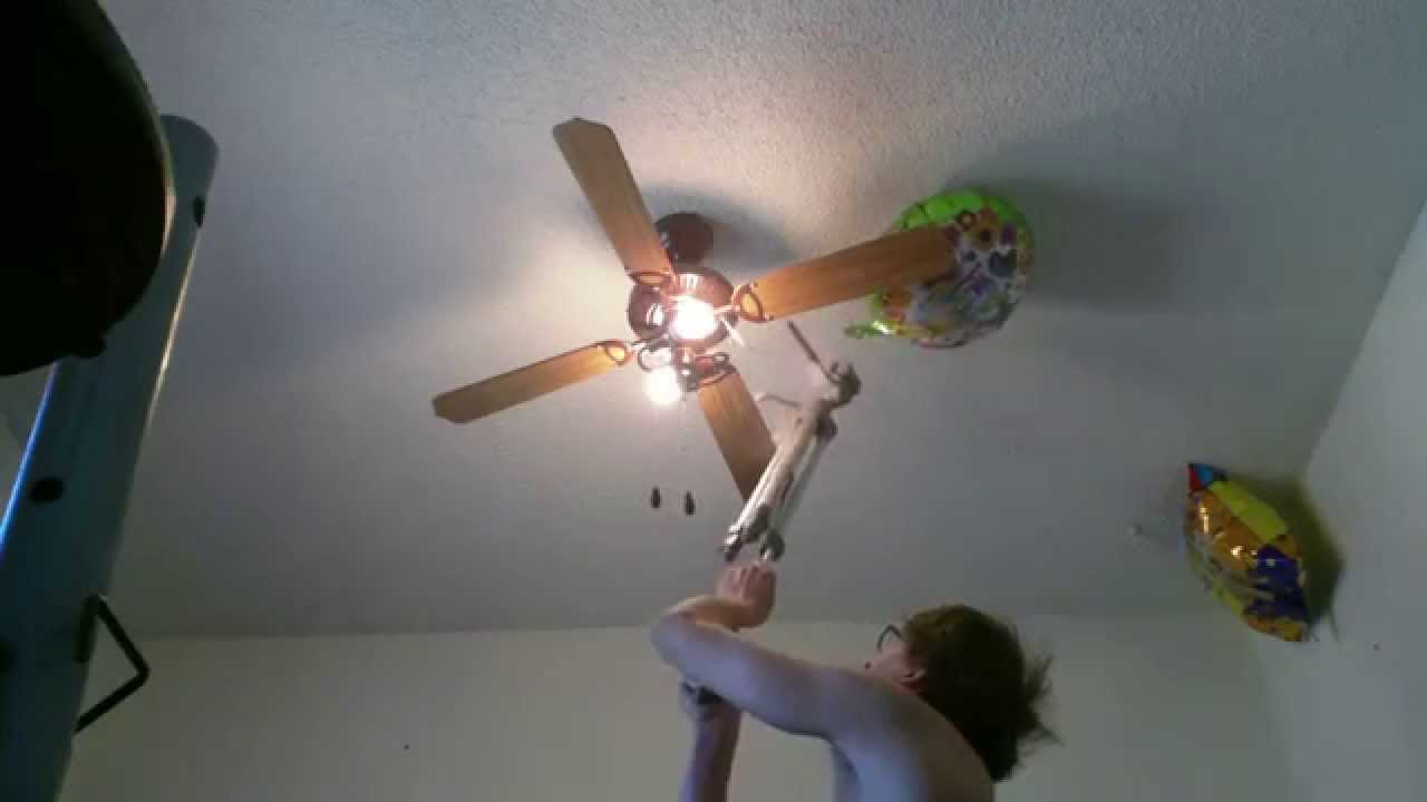 Wheelchair Style Unraveling Birthday Balloon From Ceiling Fan L1