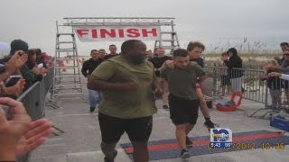 Marine honored for carrying triathlete across finish line