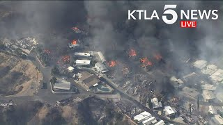Brush Fire Engulfs Mobile Home Park Near Calimesa, California