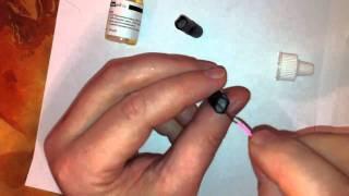 Заправка картриджа электронной сигареты.(На видео показано как заправить катридж для электронной сигареты с помощью жидкости для заправки. Подробне..., 2011-10-01T13:22:58.000Z)