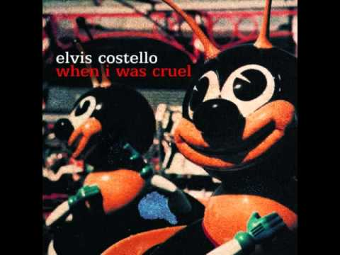 elvis costello tear off your own head it s a doll revolution
