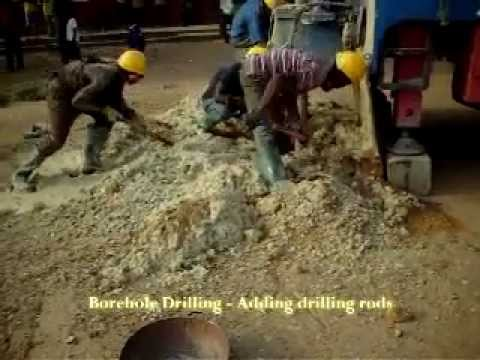 Borehole Drilling - through mud - Adding drilling rods - Enacent Limited Ghana