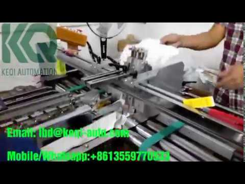 Automatic Spray gluing machine is spraying melt adhesive on medicine packaging box
