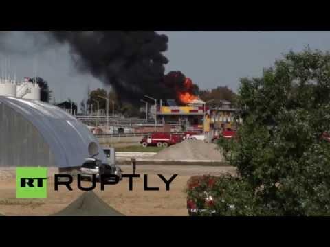 Blaze reignites after massive fuel depot explosion
