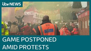 Manchester United's game postponed after fans storm pitch | ITV News