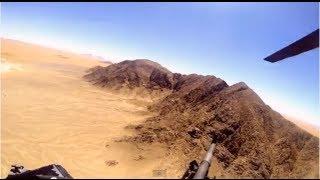 Chinook helicopter door gunner in afghanistan - aerial footage of door gunner over afghanistan