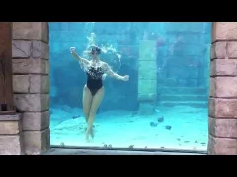 Thumbnail: Female diver underwater performs cool tricks underwater