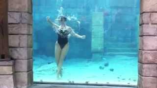 Repeat youtube video Female diver underwater performs cool tricks underwater