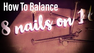 How to balance eight nails on top of one