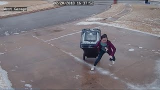 What a Chore for 11-Year-Old Trying to Carry Trash Can on Icy Driveway