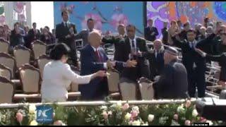 RAW: Uzbek President Dances At Nowruz Festival To Welcome Spring
