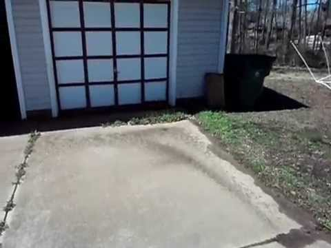 Exterior Grading Issues Cause Water Entry Into Garage