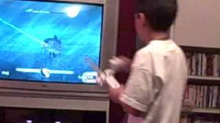 Alex playing fish frenzy on Wii