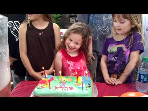 Ella blowing out the candles at her 6th bday party
