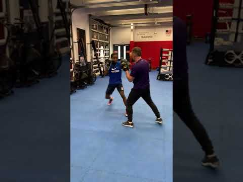 Keyshawn Davis works with USA Boxing head coach