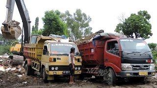 Dump Trucks Loading Debris By Volvo Excavator EC210B