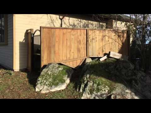 fence-construction-over-a-drop-in-landscaping-|-flue-guru