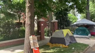 Person caught on viḋeo wielding a machete at homeless camp outside the Colorado Governor's Mansion