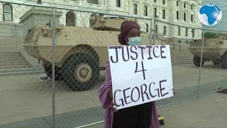 """Protesters chant """"quit your job"""" as they stand near the White House, demanding justice for Floyd"""