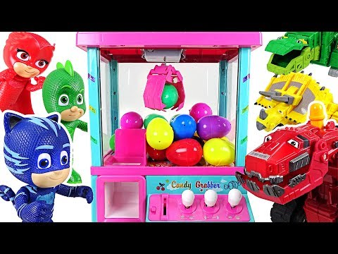 Dinotrux vs PJ Masks! Surprise eggs claw machine battle play! - DuDuPopTOY