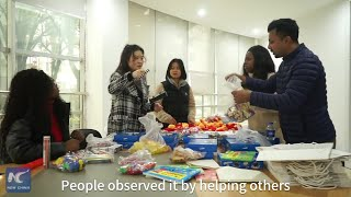 GLOBALink | Int'l volunteers help disabled children in E China