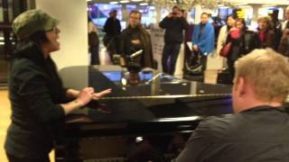 Kat Perkins Sings 'Someone Like You' by Adele in Amsterdam Airport